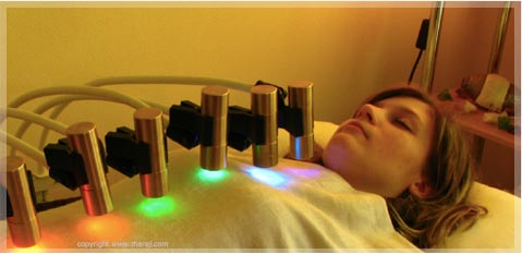 Woman receiving Maharishi Light Therapy with Gems